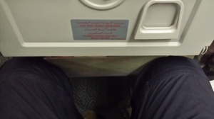 Picture showing not much leg room on an Emirates flight before the passenger in front recllined