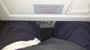 Picture showing no leg room on an Emirates flight after the passenger in front recllined